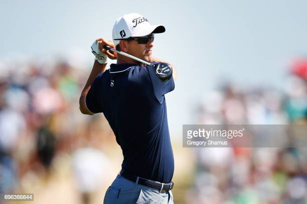Adam Scott of Australia plays his shot on the seventh hole during the first round of the 2017 US Open at Erin Hills on June 15 2017 in Hartford...