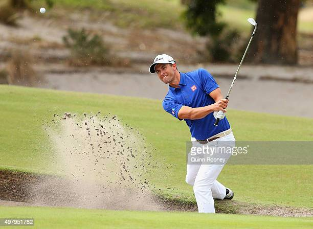Adam Scott of Australia plays out of the bunker during day two of the 2015 Australian Masters at Huntingdale Golf Club on November 20 2015 in...