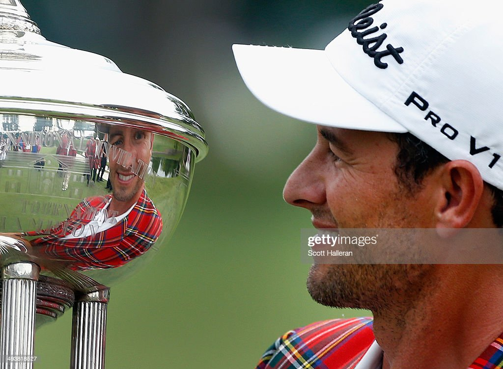 Adam Scott of Australia poses with the Leonard trophy after winning on a third playoff hole on the 18th hole during the Final Round of the Crowne Plaza Invitational at Colonial at the Colonial Country Club on May 25, 2014 in Fort Worth, Texas.