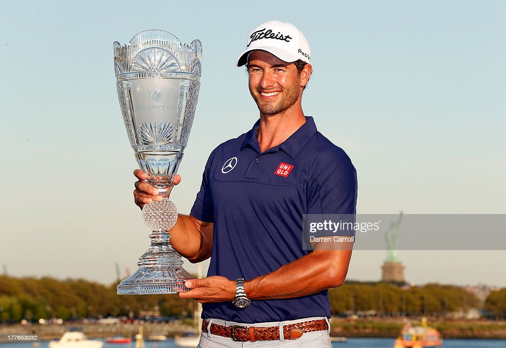 Adam Scott of Australia poses with the trophy after winning The Barclays at Liberty National Golf Club on August 25, 2013 in Jersey City, New Jersey.