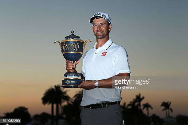 Adam Scott of Australia poses with the trophy on the 18th hole during the final round of the World Golf ChampionshipsCadillac Championship at Trump...