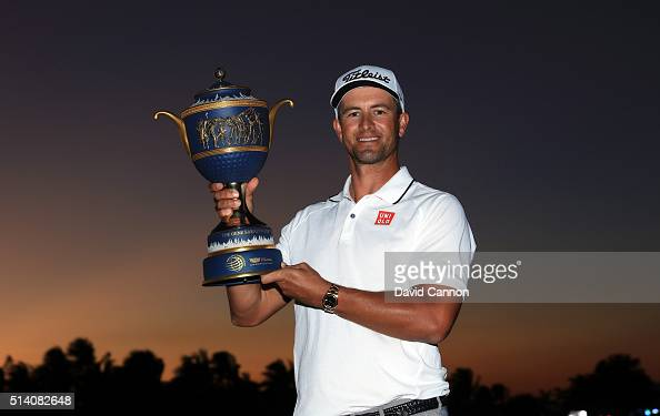 Adam Scott of Australia proudly holds the trophy after his one shot win in the final round of the 2016 World Golf Championship Cadillac Championship...