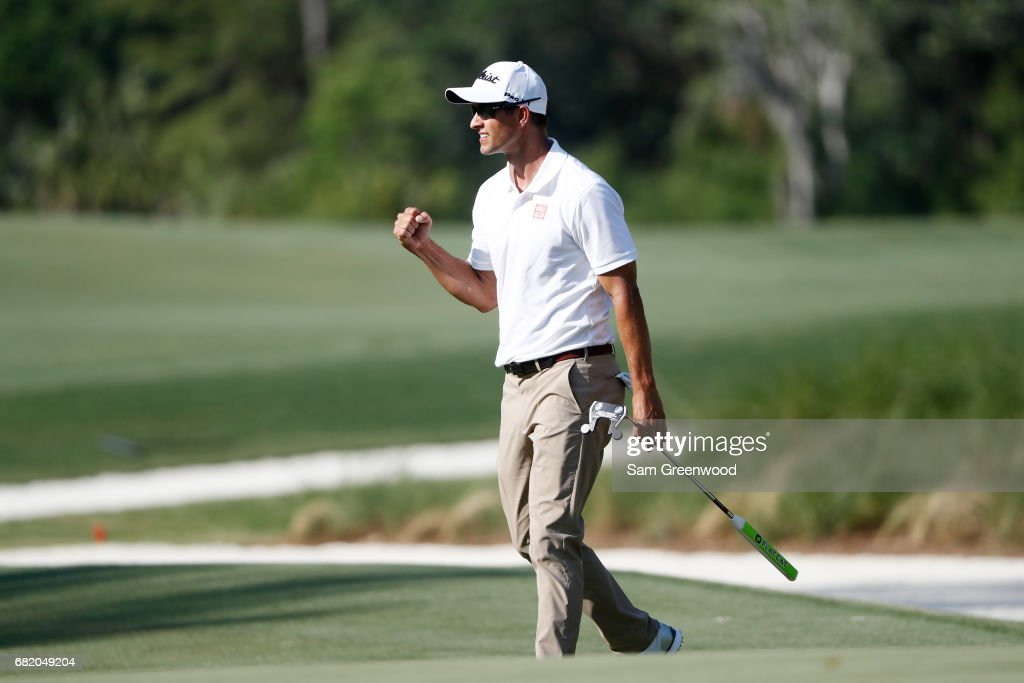 Adam Scott of Australia reacts after a birdie putt on the 14th green during the first round of THE PLAYERS Championship at the Stadium course at TPC Sawgrass on May 11, 2017 in Ponte Vedra Beach, Florida.
