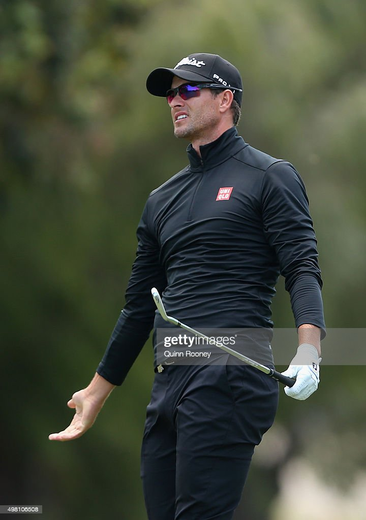 Adam Scott of Australia reacts after miss hitting an approach shot during day three of the 2015 Australian Masters at Huntingdale Golf Club on November 21, 2015 in Melbourne, Australia.