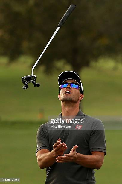 Adam Scott of Australia reacts to his missed birdie putt on the 16th hole during the third round of the World Golf ChampionshipsCadillac Championship...