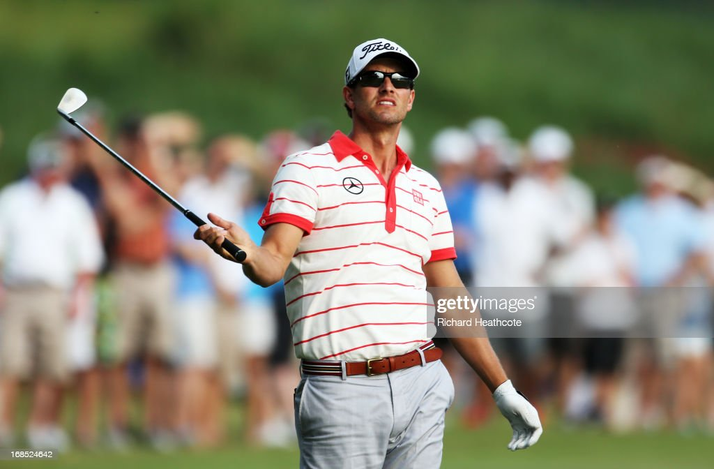 Adam Scott of Australia reacts to his second shot on the 18th hole during round two of THE PLAYERS Championship at THE PLAYERS Stadium course at TPC Sawgrass on May 10, 2013 in Ponte Vedra Beach, Florida.