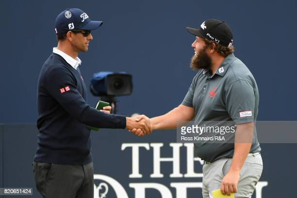 Adam Scott of Australia shakes hands with Andrew Johnston of England on the 1st tee during the third round of the 146th Open Championship at Royal...