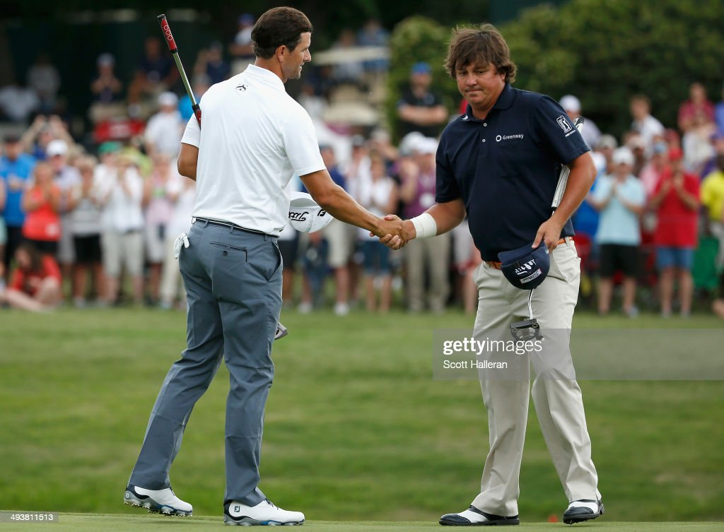 <a gi-track='captionPersonalityLinkClicked' href=/galleries/search?phrase=Adam+Scott+-+Golfer&family=editorial&specificpeople=202039 ng-click='$event.stopPropagation()'>Adam Scott</a> of Australia shakes hands with <a gi-track='captionPersonalityLinkClicked' href=/galleries/search?phrase=Jason+Dufner&family=editorial&specificpeople=561651 ng-click='$event.stopPropagation()'>Jason Dufner</a> after a birdie putt on the third playoff hole to defeat him and win the 18th hole during the Final Round of the Crowne Plaza Invitational at Colonial at the Colonial Country Club on May 25, 2014 in Fort Worth, Texas.