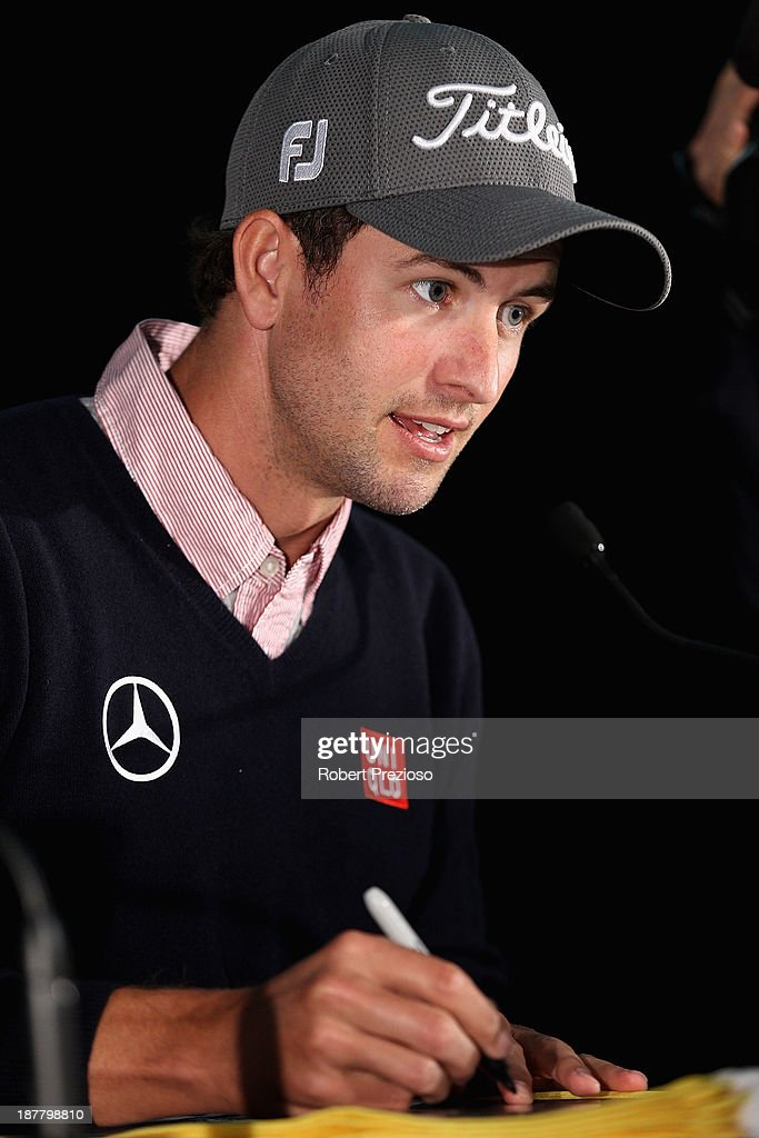 Adam Scott of Australia signs autographs during the Pro Am ahead of the 2013 Australian Masters at Royal Melbourne Golf Course on November 13, 2013 in Melbourne, Australia.