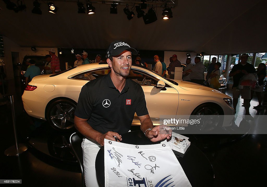 Adam Scott of Australia signs autographs for fans at the Mercedes Benz Performance Centre during a practice round prior to the start of the 96th PGA Championship at Valhalla Golf Club on August 4, 2014 in Louisville, Kentucky.