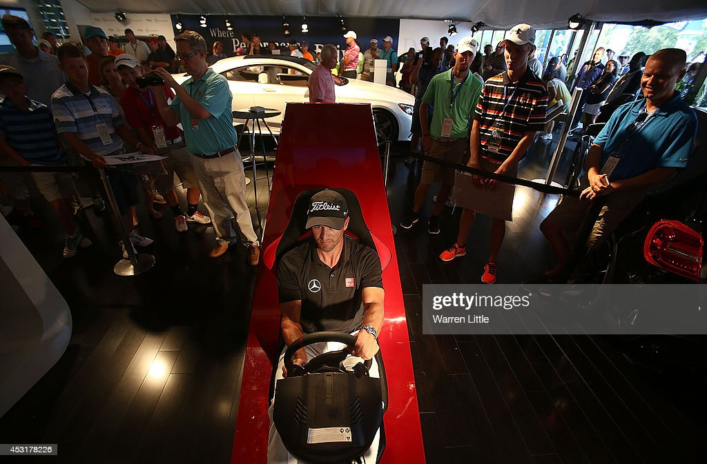 Adam Scott of Australia sits in the driving simulator at the Mercedes Benz Performance Centre during a practice round prior to the start of the 96th PGA Championship at Valhalla Golf Club on August 4, 2014 in Louisville, Kentucky.
