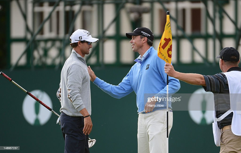 Adam Scott of Australia skakes hands with Matt Kuchar of the United States after carding a three under par round 67 on the eighteenth hole during the second round of the 141st Open Championship at Royal Lytham & St Annes Golf Club on July 20, 2012 in Lytham St Annes, England.