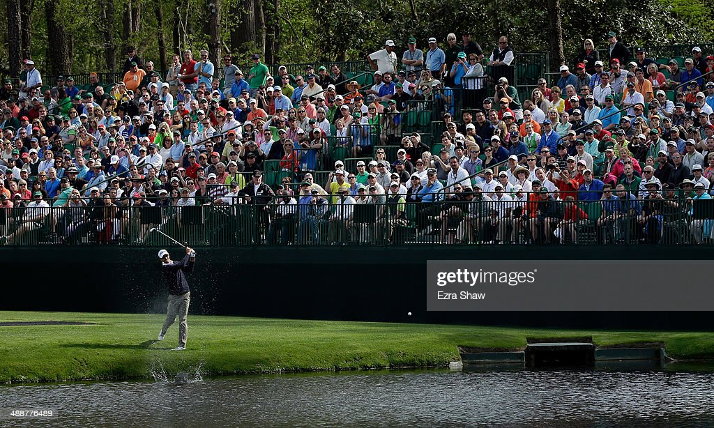 Adam Scott of Australia skips the ball across the pond on the 16th hole during a practice round at Augusta National Golf Club on April 8, 2014 in Augusta, Georgia.