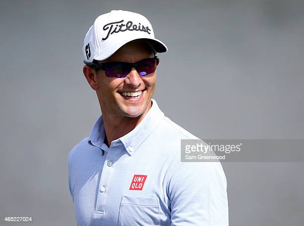 Adam Scott of Australia smiles during a practice round for World Golf ChampionshipsCadillac Championship at Trump National Doral Blue Monster course...