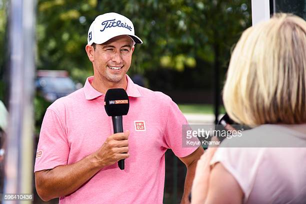 Adam Scott of Australia smiles during a Sky Sports interview following his 6under in the third round of The Barclays at Bethpage State Park on August...