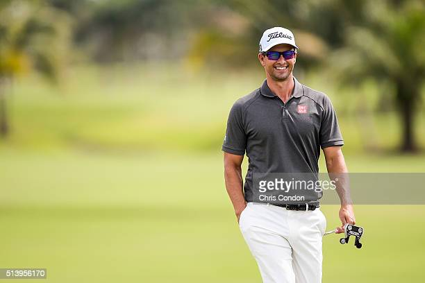 Adam Scott of Australia smiles while walking to the second hole green with his putter during the third round of the World Golf ChampionshipsCadillac...