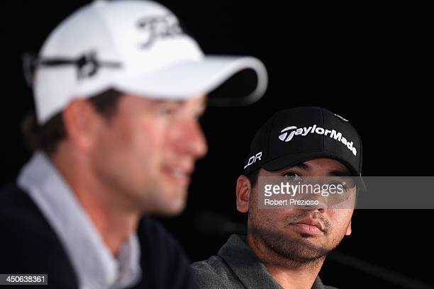 Adam Scott of Australia speaks to the media as Jason Day of Australia looks on during a press conference ahead of the World Cup of Golf at Royal...