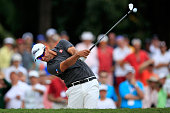 Adam Scott of Australia takes his second shot on the 14th hole during the third round of the World Golf ChampionshipsCadillac Championship at Trump...