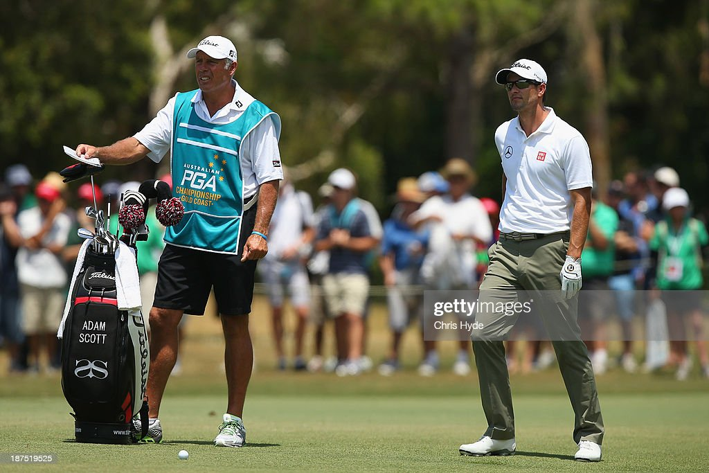 Adam Scott of Australia talk with his caddie Steve Williams during day four of the PGA Royal Pines on November 10, 2013 in Gold Coast, Australia.
