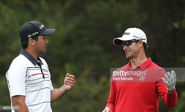 Adam Scott of Australia talks to Jason Day of Australia during day two of the Australian Open at Royal Sydney Golf Club on November 29 2013 in Sydney...