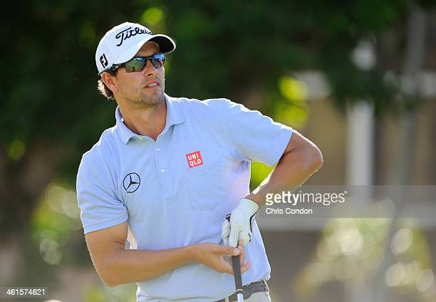 Adam Scott of Australia tees off on the first hole during the first round of the Sony Open in Hawaii at Waialae Country Club on January 9 2014 in...