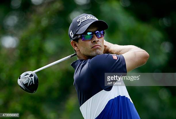 Adam Scott of Australia tees off on the third hole during round one at the Wells Fargo Championship at Quail Hollow Club on May 14 2015 in Charlotte...