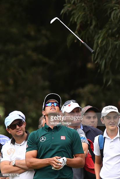 Adam Scott of Australia throws his club in the air after an approach shot to the 9th hole during day one of the 2014 Australian Masters at The...
