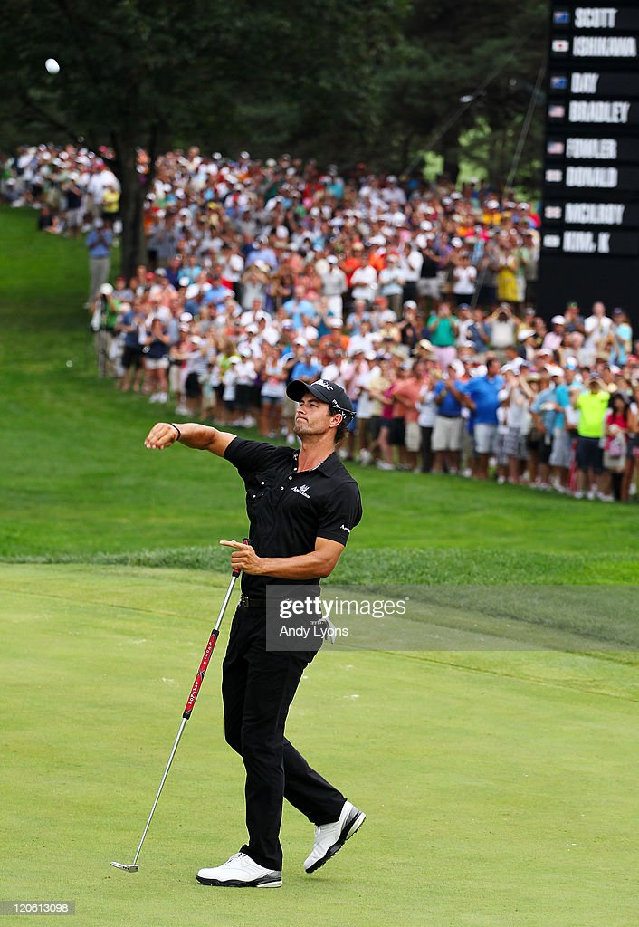 <a gi-track='captionPersonalityLinkClicked' href=/galleries/search?phrase=Adam+Scott+-+Golfer&family=editorial&specificpeople=202039 ng-click='$event.stopPropagation()'>Adam Scott</a> of Australia throws his golf ball to fans in celebration of his four-stroke victory on the 18th green after the final round of the World Golf Championships-Bridgestone Invitational on the South Course at Firestone Country Club on August 7, 2011 in Akron, Ohio.