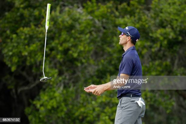 Adam Scott of Australia tosses his putter after missing a putt for birdie on the second green during the third round of THE PLAYERS Championship at...