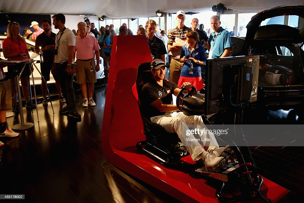 Adam Scott of Australia uses the driving simulator in the Mercedes Benz Performance Centre during a practice round prior to the start of the 96th PGA Championship at Valhalla Golf Club on August 4, 2014 in Louisville, Kentucky.