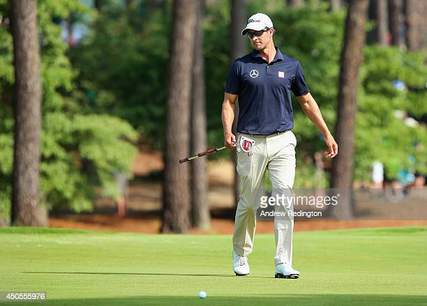 Adam Scott of Australia walks across the first green during the second round of the 114th US Open at Pinehurst Resort Country Club Course No 2 on...
