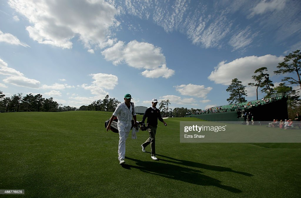 Adam Scott of Australia walks off the 17th green with his caddie Steve Williams during a practice round at Augusta National Golf Club on April 8, 2014 in Augusta, Georgia.