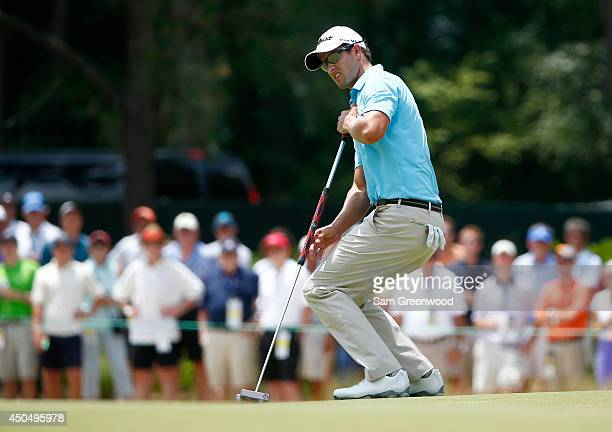 Adam Scott of Australia watches a putt on the first green during the first round of the 114th US Open at Pinehurst Resort Country Club Course No 2 on...