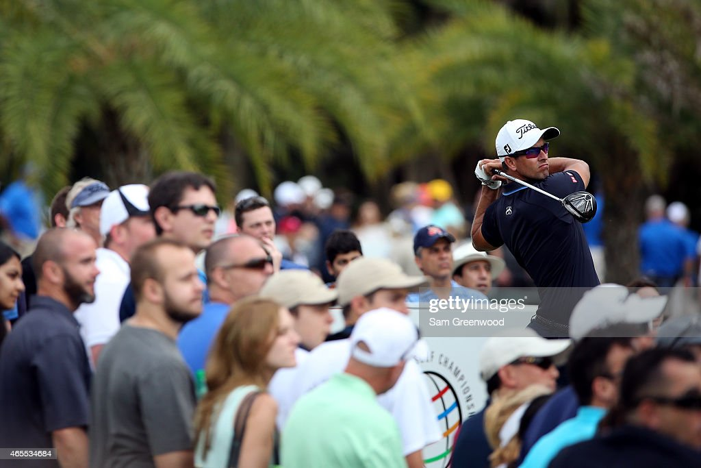 Adam Scott of Australia watches his tee shot on the seventh hole during the third round of the World Golf ChampionshipsCadillac Championship at Trump...