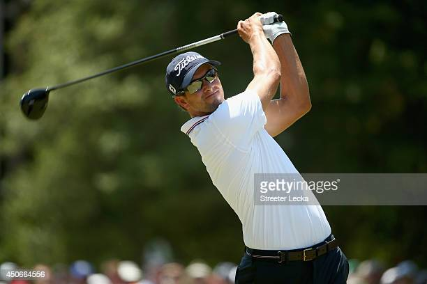 Adam Scott of Australia watches his tee shot on the third hole during the final round of the 114th US Open at Pinehurst Resort Country Club Course No...