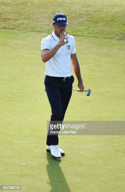 Adam Scott of Australia waves on the 18th green during the first round of The 143rd Open Championship at Royal Liverpool on July 17 2014 in Hoylake...