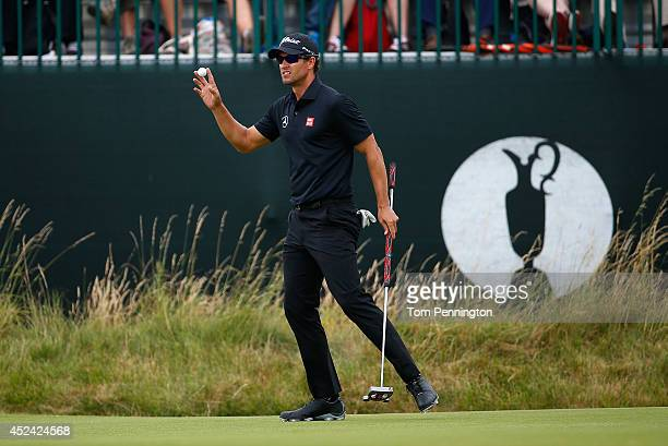 Adam Scott of Australia waves to the gallery after a birdie on the third green during the final round of The 143rd Open Championship at Royal...