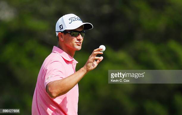 Adam Scott of Australia waves to the gallery on the 18th green after his sixunder par 65 during the third round of The Barclays in the PGA Tour...