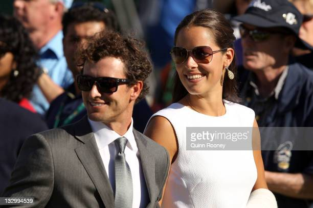 Adam Scott of the International Team and his partner Serbian tennis player Ana Ivanovic attend the Opening Ceremony prior to the start of the 2011...
