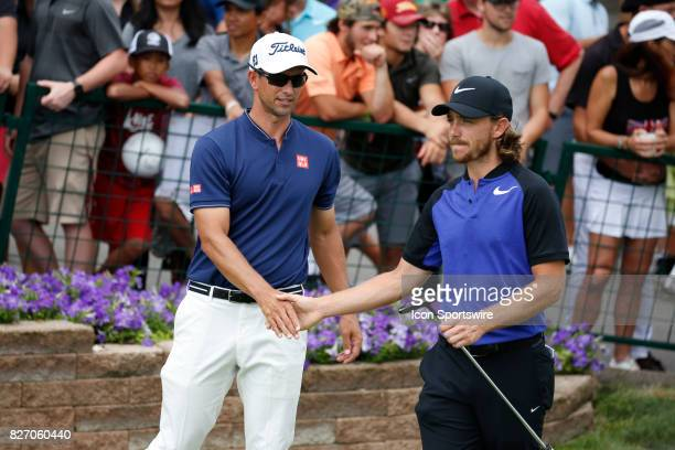 Adam Scott shakes hands with Tommy Fleetwood before teeing off on the first hole during the final round of the World Golf ChampionshipBridgestone...
