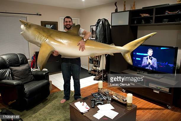 Adam Shearer stands in his living room with his 8foot mounted wall shark that he just sold on Craigslist His grandfather caught the shark in Florida...