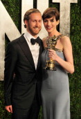 Adam Shulman and actress Anne Hathaway arrive at the 2013 Vanity Fair Oscar Party at Sunset Tower on February 24 2013 in West Hollywood California