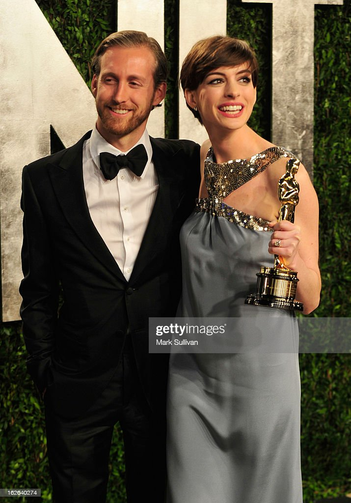 Adam Shulman and actress Anne Hathaway arrive at the 2013 Vanity Fair Oscar Party at Sunset Tower on February 24, 2013 in West Hollywood, California.