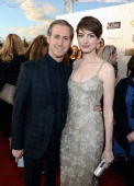 Adam Shulman and actress Anne Hathaway attend the 18th Annual Critics' Choice Movie Awards held at Barker Hangar on January 10 2013 in Santa Monica...