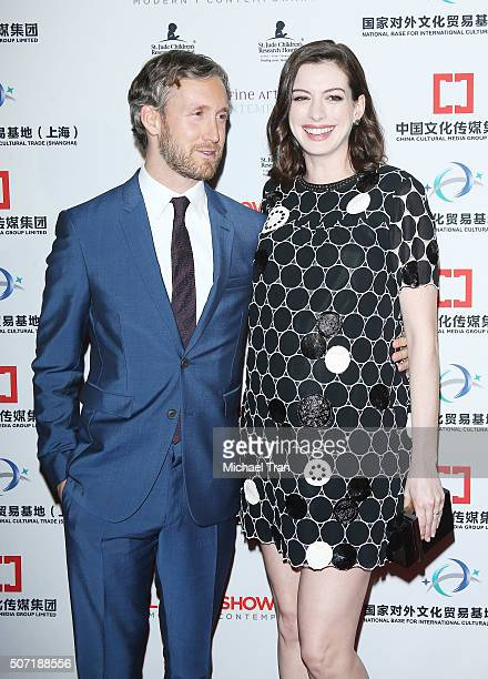 Adam Shulman and Anne Hathaway arrive at the LA Art Show and Los Angeles Fine Art Show's 2016 opening night premiere party benefiting St Jude...
