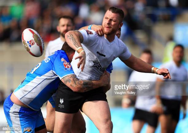 Adam Sidlow of Toronto Wolfpack passes the ball in the second half of a Kingstone Press League 1 match against Barrow Raiders at Lamport Stadium on...