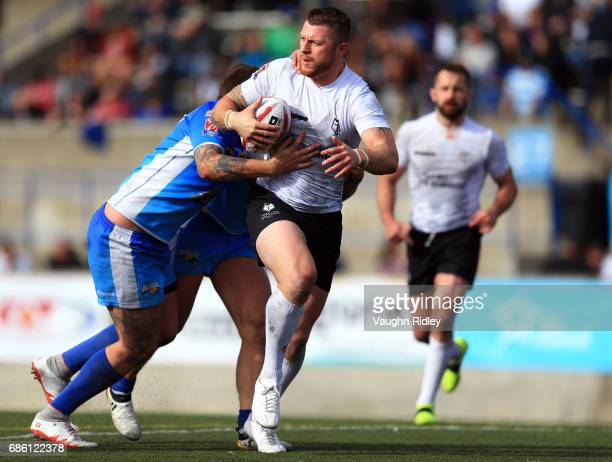 Adam Sidlow of Toronto Wolfpack runs with the ball in the second half of a Kingstone Press League 1 match against Barrow Raiders at Lamport Stadium...