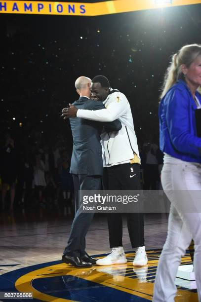 Adam Silver congratulates Draymong Green of the Golden State Warriors during the NBA Championship ring ceremony for the Golden State Warriors before...