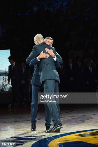 Adam Silver congratulates Rick Welts during the NBA Championship ring ceremony for the Golden State Warriors before the game against the Houston...