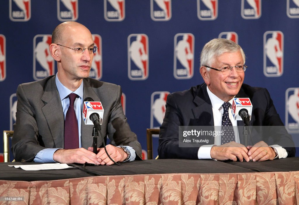 Adam Silver (L), Deputy Commissioner of the NBA, speaks to the media following the NBA Board of Governors Meeting, during which Commissioner David Stern (R) outlined his plans to step down in February 2014 and nominate Silver as his successor, at the St. Regis hotel on October 25, 2012 in New York City.